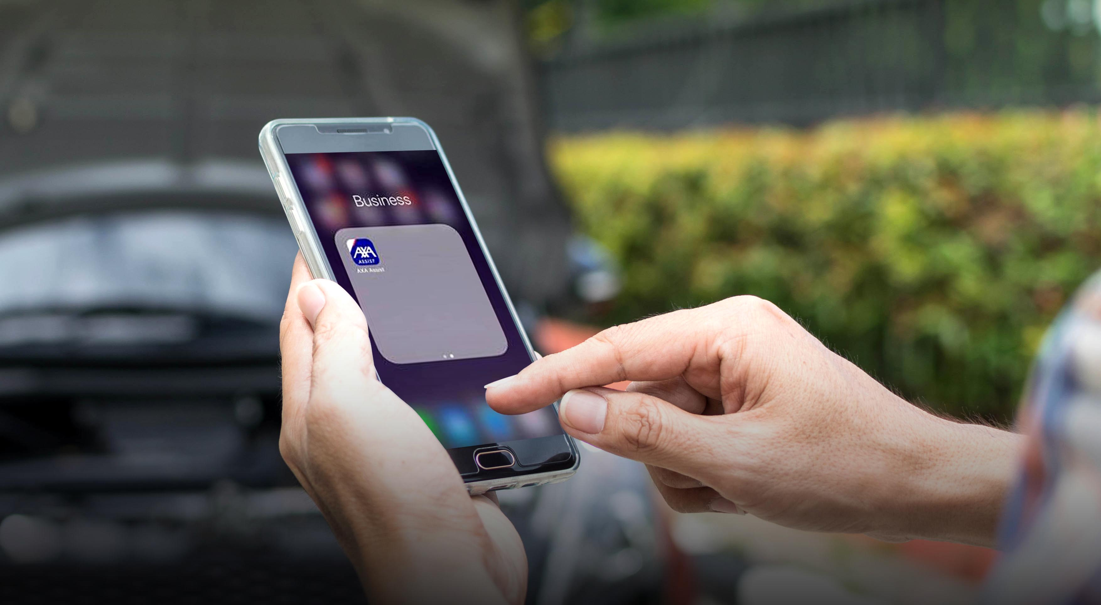 AXA now offers one-touch red button emergency assistance  to motor policyholders